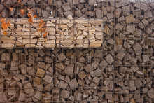 The Texture Of The Gabion Fence Is Made Of Natural Stone And Metal Mesh