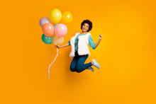 Full Length Photo Funky Crazy Afro American Girl Jump Hold Balons Win Event Scream Yes Raise Fists Wear White Teal Stylish Trendy Sweater Blue Pants Trousers Isolated Bright Color Background