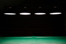 Pool Table Lit By Lamps On A Dark Background. Low Key Shooting In Low Light