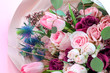 canvas print picture - A closeup bouquet of roses and tulips decorated with leaves and twigs of other beautiful plants. Holiday concept. Flowers for Mother's Day. Copy space.