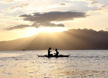 One Man Rowing And One Man On ...
