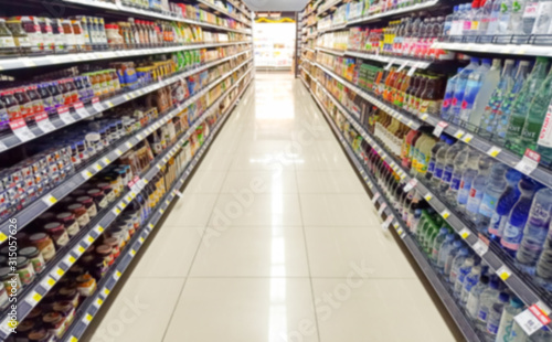 Photo Blurred Background Abstract Bokeh Shelving unit in Shopping store supermarket look at the lights