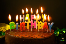 Birthday Cake With Candles On A Yellow Background