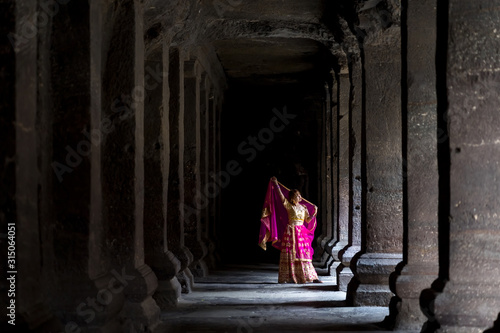 A Lady touring the Ellora Cave Ruins in India