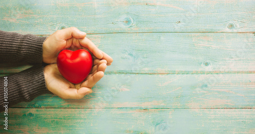 red heart with a jar of money Wallpaper Mural