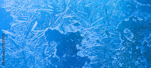 Fototapeta Abstract ice flowers pattern, frosted window macro view background. cold winter weather xmas backdrop