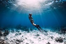Woman Free Diver With Fins Gli...