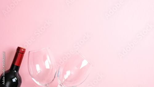 Fototapety, obrazy: Valentines day greeting card template. Bottle of wine and glasses on pink background. Top view with copy space. Valentine's day, love, romance concept