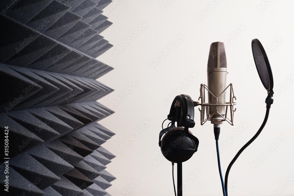 Fototapeta Recording studio equipment: microphone, acoustic foam, headphones