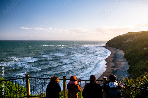Group of people are looking at the view of the ocean at sunset Canvas Print