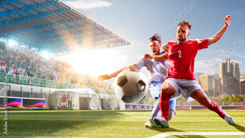 Fototapeta Soccer players in action on the day grand stadium background panorama