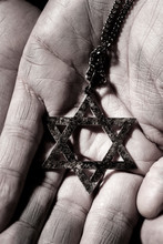 The Star Of David In The Hands Of A Man