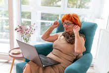 Elderly Woman Using Laptop Com...
