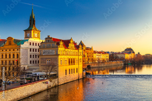 Obraz Historic buildings on the Vltava river bank at sunset in Prague, Czech Republic, Europe. - fototapety do salonu