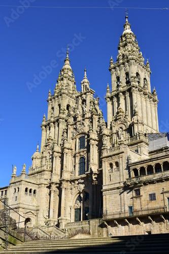 Cathedral, baroque facade and towers from Praza do Obradoiro with blue sky Fototapeta