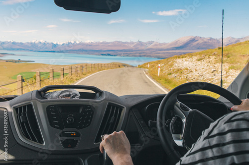 Photo Photo of a person driving a campervan in New Zealand