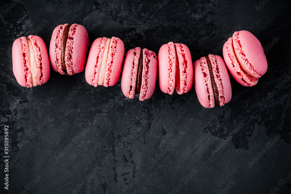 Fototapeta Valentines day pink cake macarons on dark background