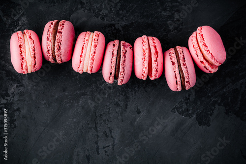 Fototapeta Valentines day pink cake macarons on dark background obraz