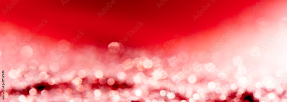 Fototapeta Red blurred abstract shiny valentines day background with bokeh effect, festive pink glitter sparkles