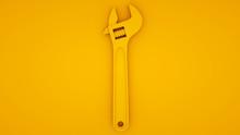 Adjustable Wrench On Yellow Ba...