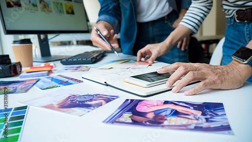 Fototapeta Advertising agency designer creative start-up team discussing ideas in office.  obraz