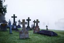 Crosses On Gravestones In Ethereal Foggy Cemetery