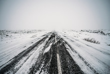 Diminishing Perspective Remote Snow Covered Road