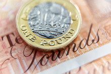 Close Up One Pound Coin On Ten Pound Note
