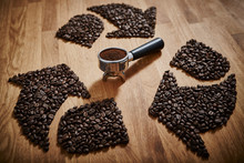 Coffee Beans Forming Recycle Symbol Around Espresso Grounds In Portafilter