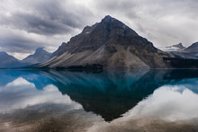 Tranquil View Of Craggy Mountains And Placid Bow Lake, Alberta, Canada