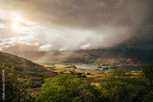 Tranquil, majestic view of clouds over sunny remote landscape, Kerry, Ireland - 315111840