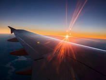 Sunset Behind Airplane Wing In...
