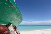 Boat Propped Up On Sunny Ocean Beach, Maldives
