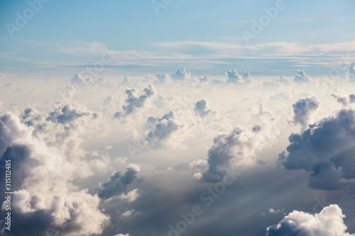 Aerial view fluffy white clouds in sunny, ethereal sky - 315112485