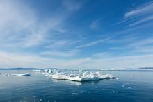 Polar Ice Melt On Sunny Blue A...
