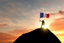 French Flag Being Waved At The...