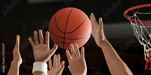 Obraz na plátně Basketball ball is flying with basketball hoop over a basketball court