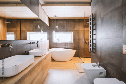 Obraz na plátně Stylish bathroom with wooden and concrete walls and white bath