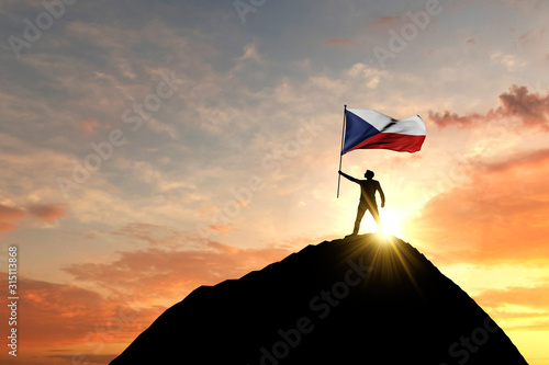 Photo  Czech Republic flag being waved at the top of a mountain summit