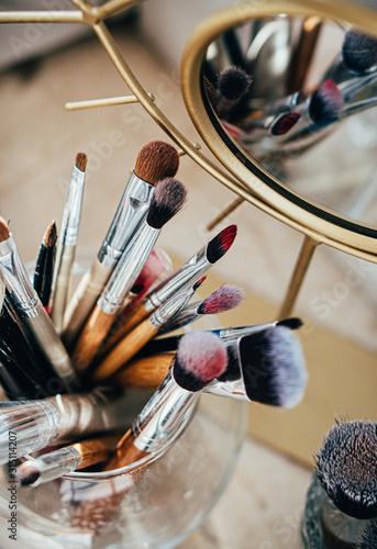 Fototapeta Many different makeup brushes in artist's studio with mirror reflection obraz na płótnie
