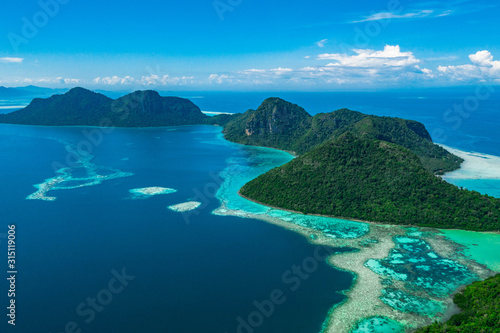 Cuadros en Lienzo Amazing tropical paradise islands from air with blue turquoise blue lagoon water and coral reef