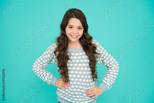 Feeling good fabulous hairstyle. Happy girl wear wavy hairstyle blue background. Little child with long brunette hair. Cool hairstyle. New look new hairstyle. Beauty hair salon
