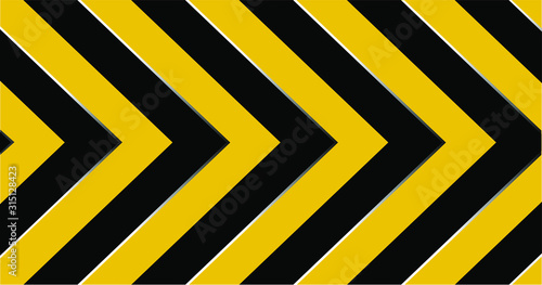 Photo warning sign with black stripes on yellow background.
