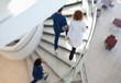 Hospital staff climbing spiral steps