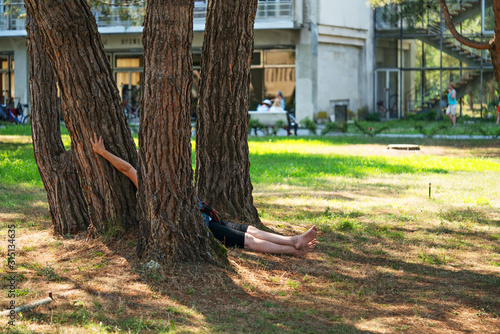 Aunt resting in the shade of a tree. Canvas Print