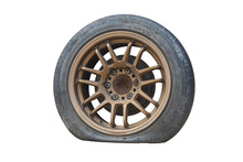 Close Up Old Tire And Flat Tire  Isolated On White Background. Save With Clipping Path. Tire Leak.