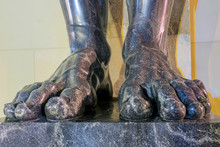 Legs . Atlantes Statue In St. ...