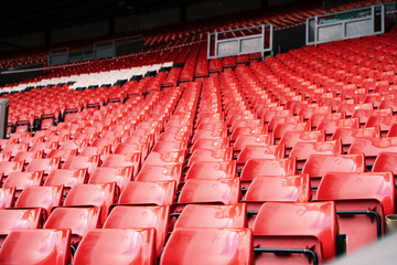Bright red stadium seat in Liverpool.