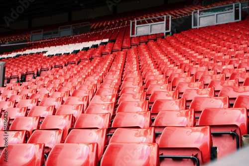 Photo  Bright red stadium seat in Liverpool.