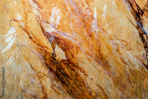 Wall with structure of yellow brown amber and abstract patterns Wallpaper Mural